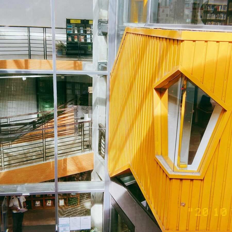 A Picture Containing Yellow, Building, Cage  Description Automatically Generated