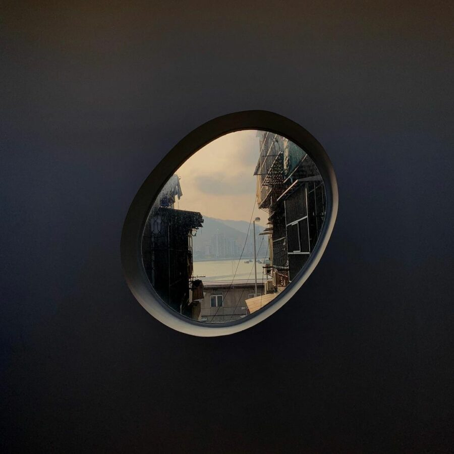 A Picture Containing Mirror, Reflection, Round, Car Mirror  Description Automatically Generated