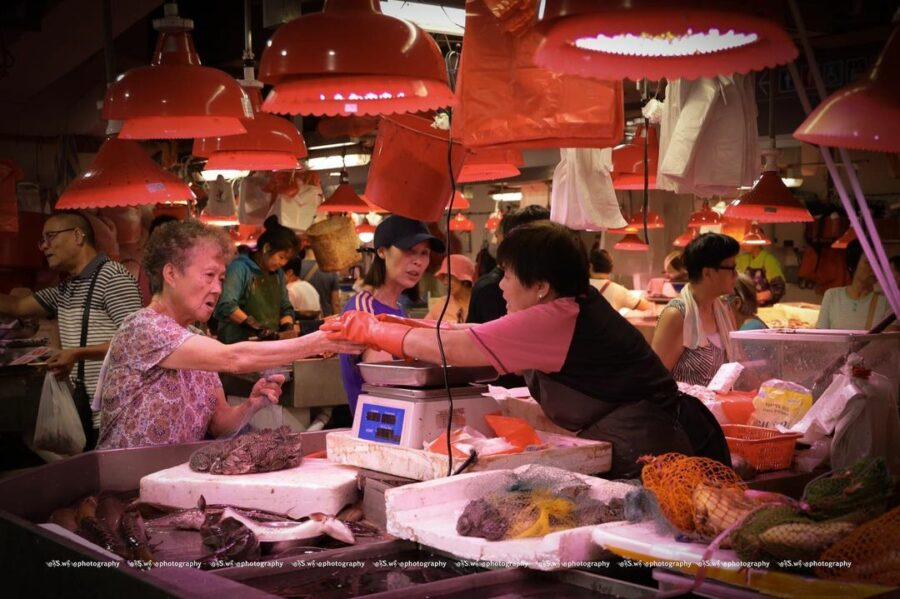 A Group Of People At A Market  Description Automatically Generated With Low Confidence